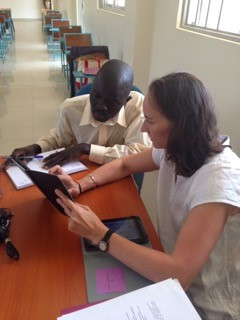 Nurse educator, Karen, trains her counterpart and head of the nursing department on the Health eVillages tablet in Uganda.